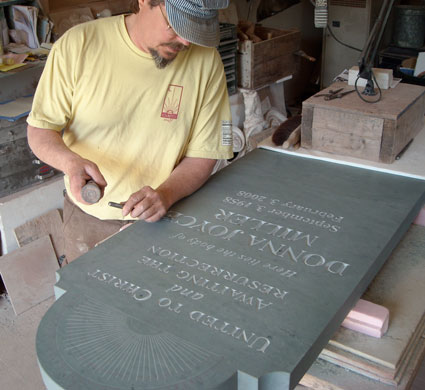 Michael lettering in his shop